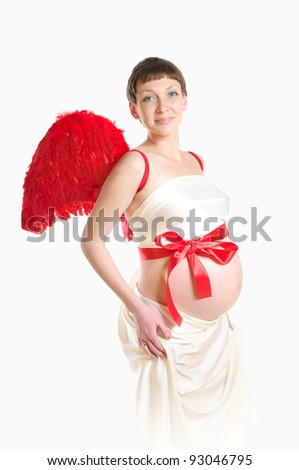 Portrait of a beautiful pregnant woman with red wings - stock photo