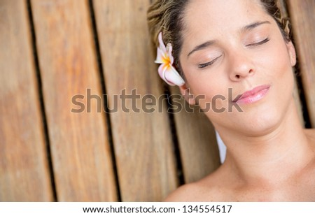 Portrait of a beautiful relaxed woman at the spa - stock photo