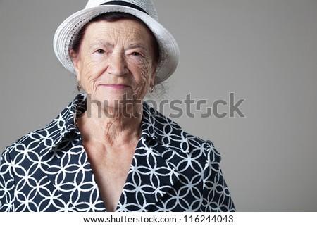 Portrait of a beautiful retired happy senior woman. - stock photo