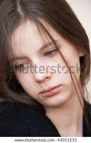 Portrait of a beautiful sad girl in black blouse - stock photo