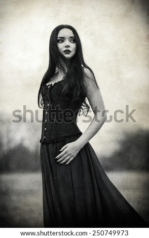 Portrait of a beautiful sad goth girl. Grunge texture effect - stock photo