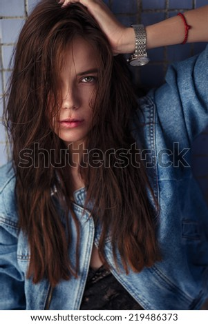 portrait of a beautiful sexy brunette with attractive look - stock photo