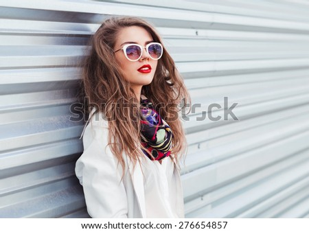 portrait of a beautiful sexy girl in sunglasses with red lips - stock photo