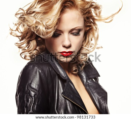 Portrait of a beautiful sexy woman in black leather jacket - stock photo