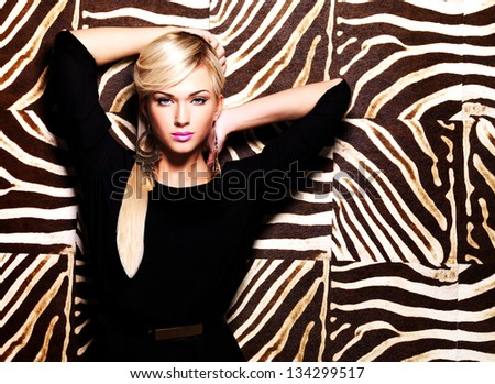 Portrait of a beautiful sexy woman with fashion makeup on face and long white hairs. Glamour girl poses over creative striped background - stock photo