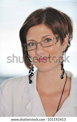 Portrait of a beautiful smiling female doctor - stock photo