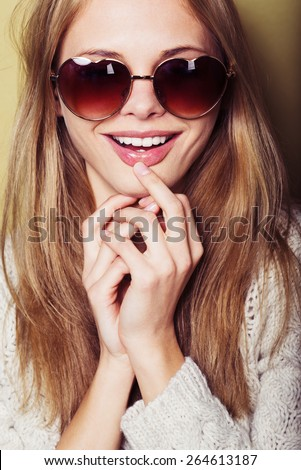 portrait of a beautiful smiling girl in sunglasses - stock photo