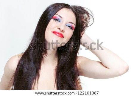 Portrait of a beautiful smiling girl with long beautiful hair and with professional bright make-up - stock photo