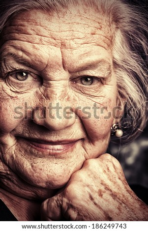 Portrait of a beautiful smiling senior woman.  - stock photo