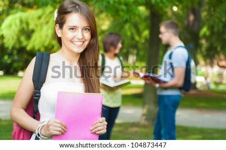 Portrait of a beautiful smiling student - stock photo