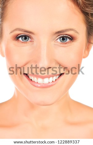 Portrait of a beautiful smiling young woman. Isolated over white background - stock photo