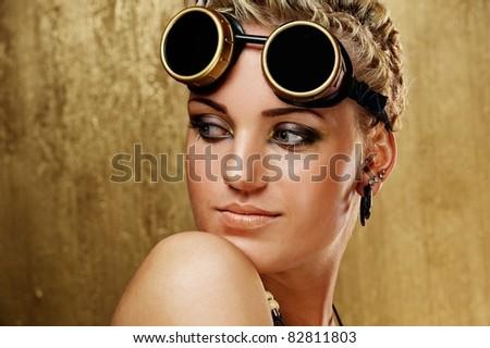 Portrait of a beautiful steam punk girl. - stock photo