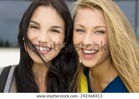 Portrait of a beautiful two young girls smiling - stock photo