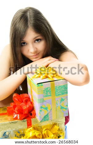 portrait of a beautiful upset young woman with a lot of presents - stock photo