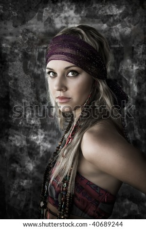 portrait of a beautiful woman against a textured background - stock photo
