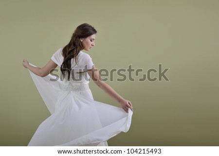 Portrait of a beautiful woman dressed as a bride isolated on white background in studio - stock photo