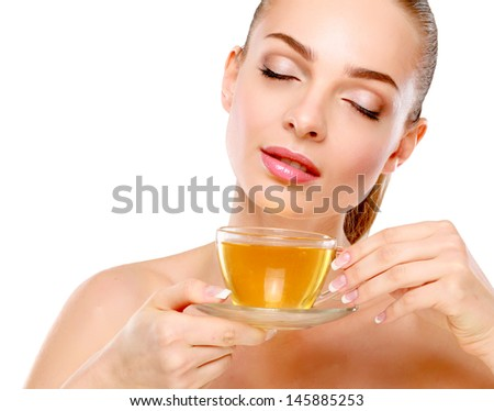 portrait of a beautiful woman drinking tea, isolated on white background - stock photo