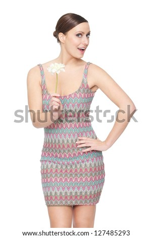 Portrait of a beautiful woman holding a flower - stock photo