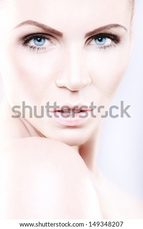 Portrait of a beautiful woman in a delicate makeup - stock photo