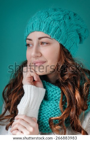 Portrait of a beautiful woman in a knitted hat  - stock photo