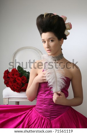 Portrait of a beautiful woman in rococo dress - stock photo