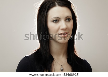 Portrait of a beautiful woman in studio. - stock photo
