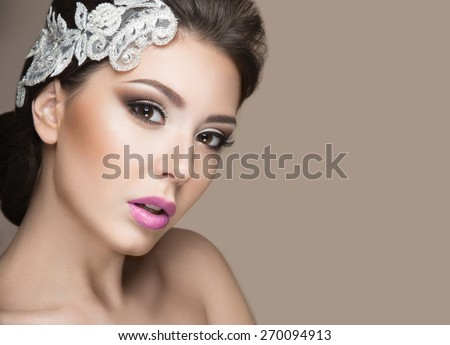 Portrait of a beautiful woman in the image of the bride with lace in her hair. Picture taken in the studio on a grey background. Beauty face - stock photo