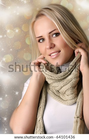 Portrait of a beautiful woman in the scalf - stock photo
