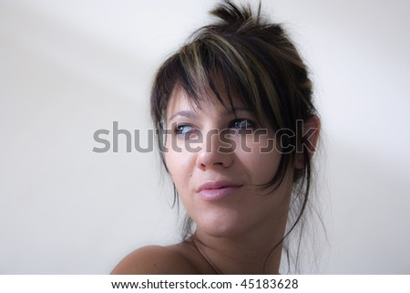 Portrait of a beautiful woman looking over her shoulder. - stock photo