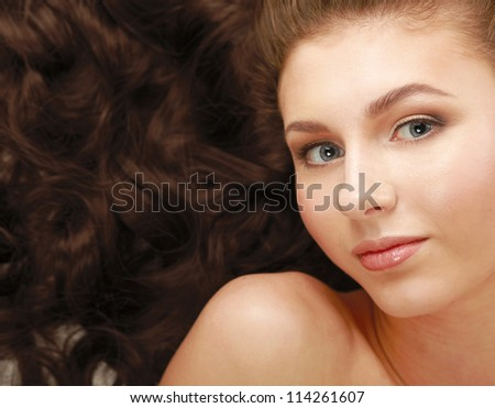 Portrait of a beautiful woman lying on the floor - stock photo