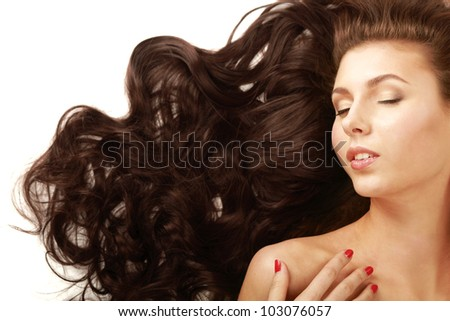 Portrait of a beautiful woman lying on the floor  isolated on white background. - stock photo