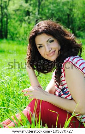 Portrait of a beautiful woman on meadow - stock photo