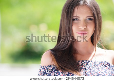 Portrait of a beautiful woman. Portrait close up of young beautiful woman. beautiful young attractive woman outdoors portrait in the street - stock photo
