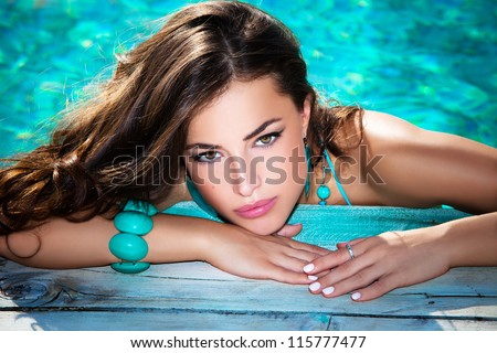 portrait of a beautiful woman posing by the pool, summer day, outdoor - stock photo