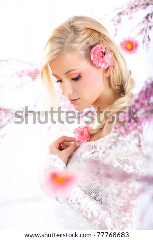 Portrait of a beautiful woman with blossoms, spring - stock photo