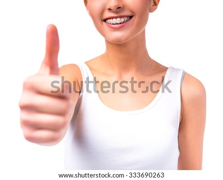 Portrait of a beautiful woman with braces on teeth, isolated on a white background - stock photo
