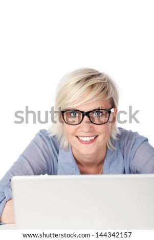 Portrait of a beautiful woman with glasses using laptop against white background - stock photo
