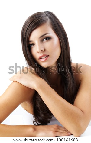 Portrait of a beautiful woman with long hair looking at camera - stock photo