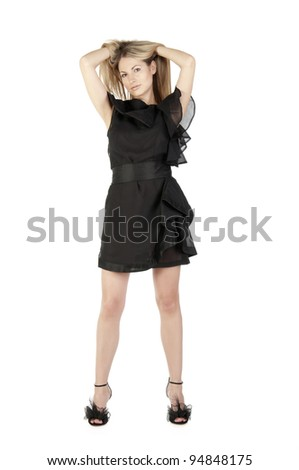 Portrait of a beautiful woman with long hairs in black dress on white background - stock photo