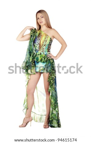 Portrait of a beautiful woman with long hairs in green dress on white background - stock photo