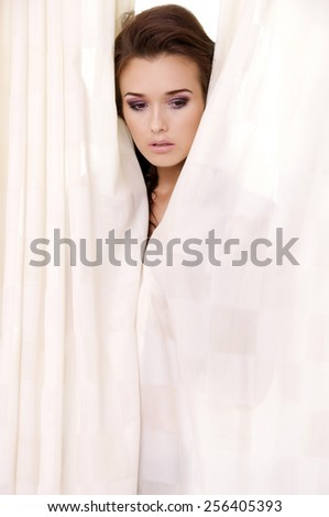 portrait of a beautiful young adult sensuality attractive and sexy pretty brunette woman on the window - stock photo