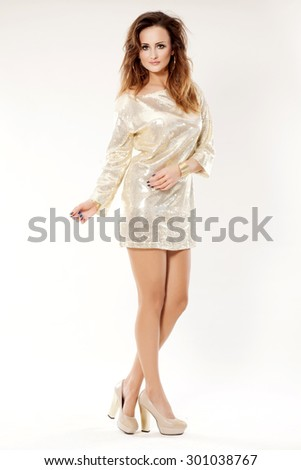 Portrait of a beautiful young adult sensuality sexy and attractive pretty brunette woman in shiny silver carnival creation elegance dress isolated on white background - stock photo