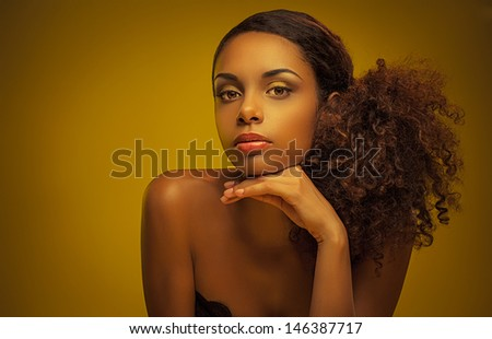 Portrait of a beautiful young African woman. - stock photo