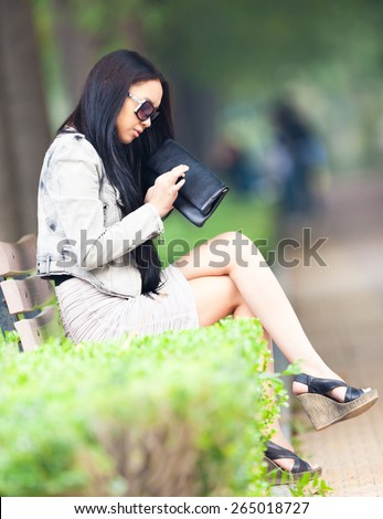 Portrait of a beautiful young asian woman with glasses. - stock photo