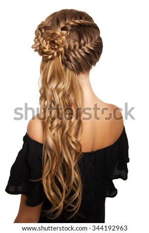 portrait of a beautiful young blonde woman on a light background with hairdo on her head. copy space. - stock photo