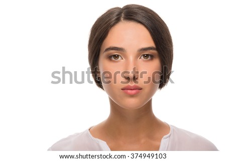 portrait of a beautiful young brunette on a white background - stock photo