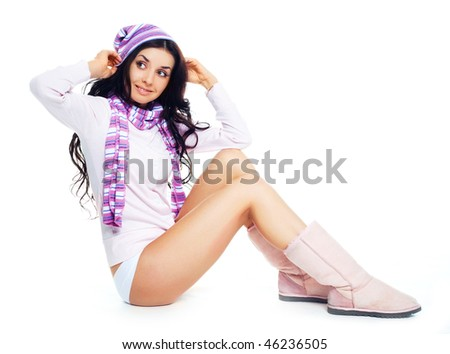 portrait of a beautiful young brunette woman wearing winter clothes - stock photo