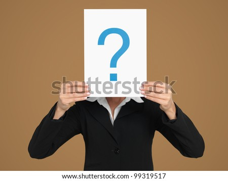 portrait of a beautiful, young, businesswoman, holding a sheet of paper with a question mark sign in front of her head, on beige background - stock photo