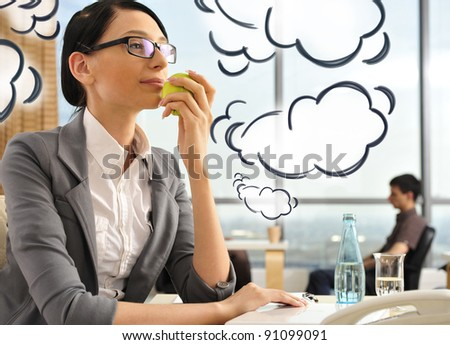 Portrait of a beautiful young businesswoman thinking. Office background. Blank cloud balloons with her thoughts flying around her - stock photo
