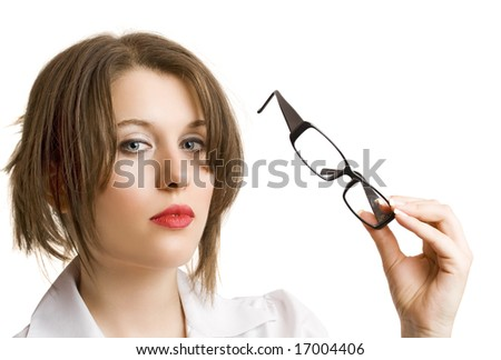 portrait of a beautiful young businesswoman with glasses in her hand - stock photo